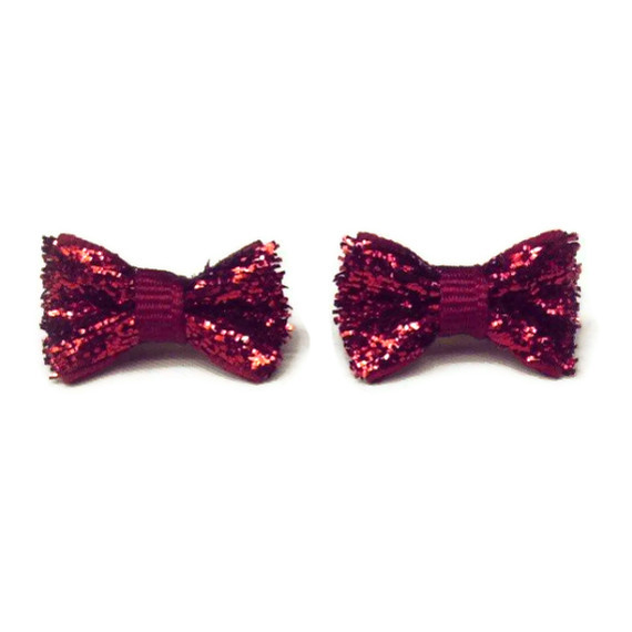 You'll be the talk of the party with these red glitter bow earrings... coming soon!